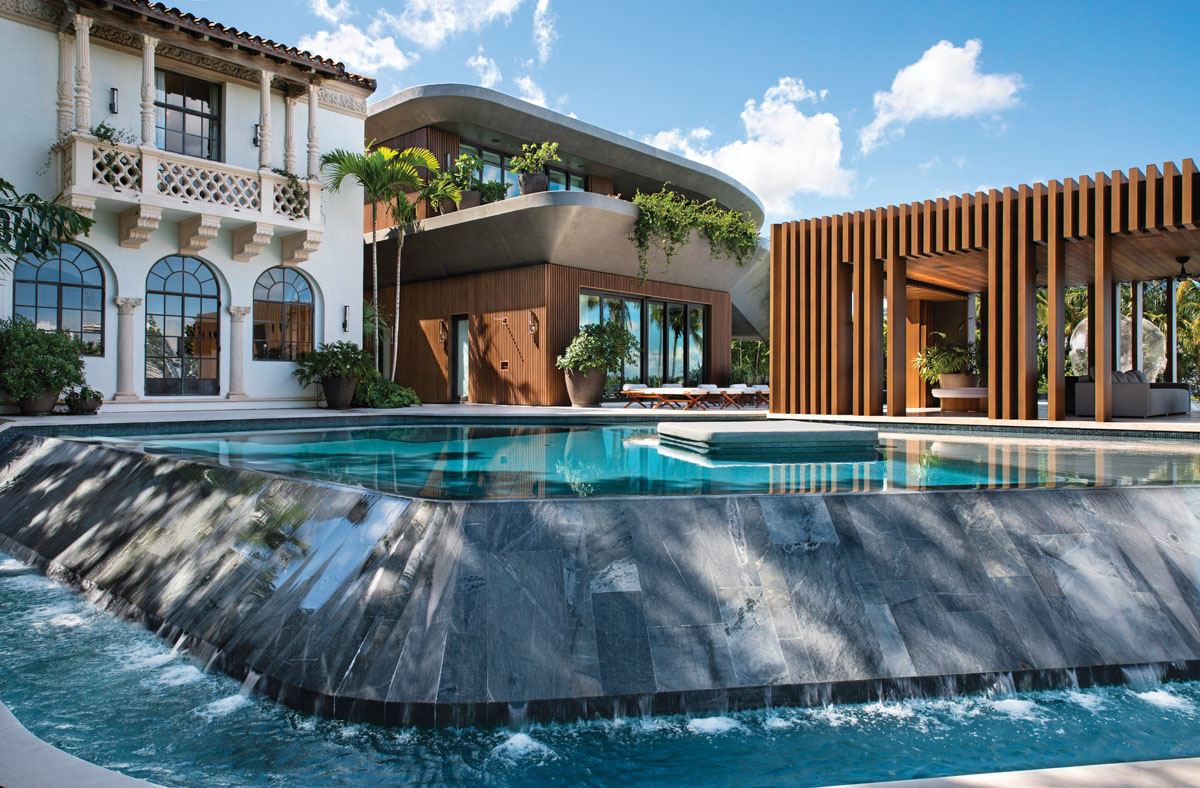 At the back of the main residence along with its Meditteranean-style guest house, a massive pool area features floating daybeds and a metal-slatted cabana.