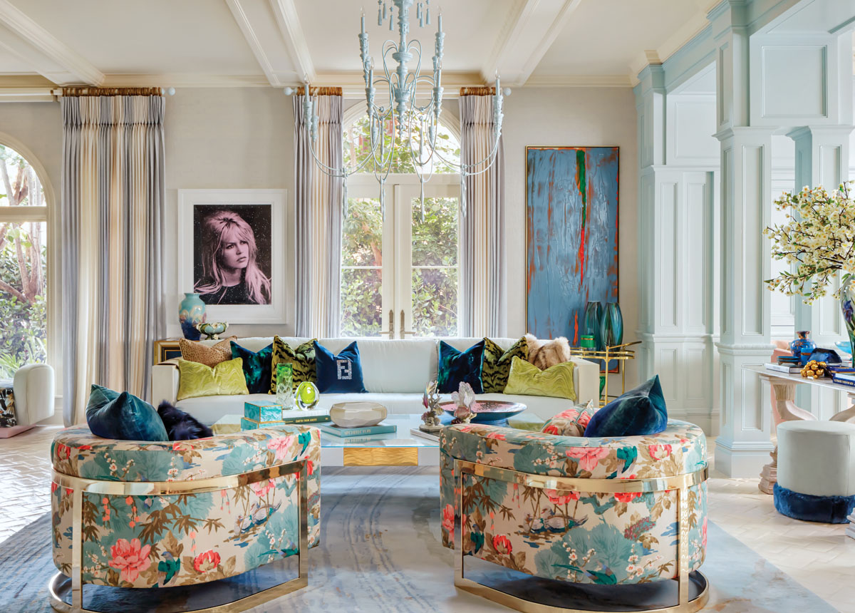 A Brigitte Bardot silkscreen by artist Russell Young looks beyond a Bretby Art Pottery vase, circa 1895, in the billiard room, where Currey & Company's painted blue chandelier purposely fades into the ceiling.