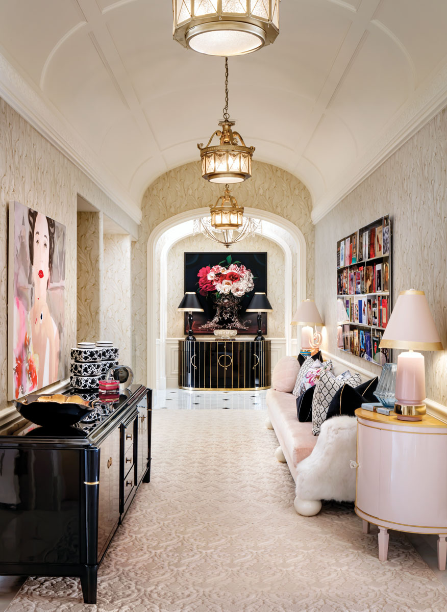 Lined with antiques, Art Deco pieces and Morris' own designs, the galleria hall showcases art including Liz Markus' Babe Paley from Brintz Gallery, RAFF AM by Max-Steven Grossman, and at the end of the hallway, Camelias in a Silver Punch Bowl by TM Glass.