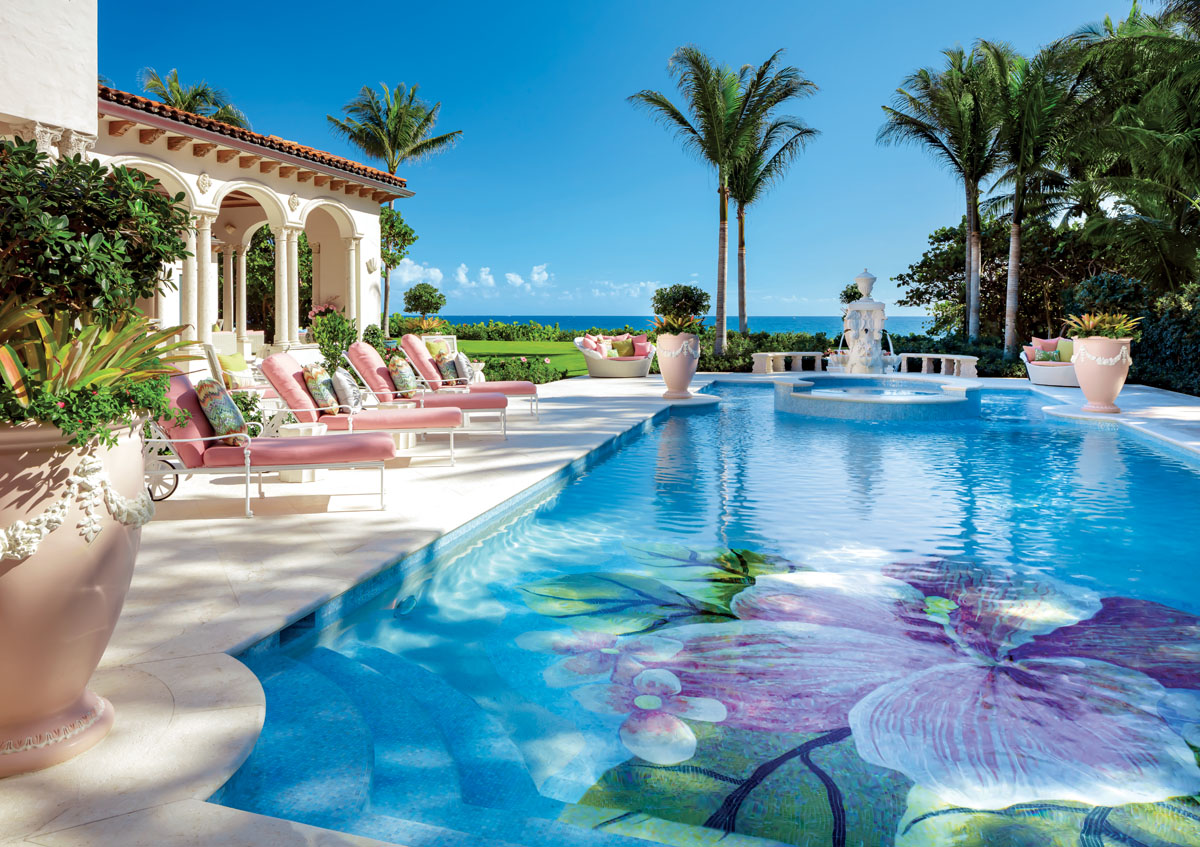 """""""The colors of the pool area are inspired by the flamboyant hues at sunset,"""" the designer says. Painting even the giant urns pink, and pinker still the Dedon's """"Orbit"""" daybeds, she feels she captured the ephemeral glow that arises from the setting and lingers in the air."""