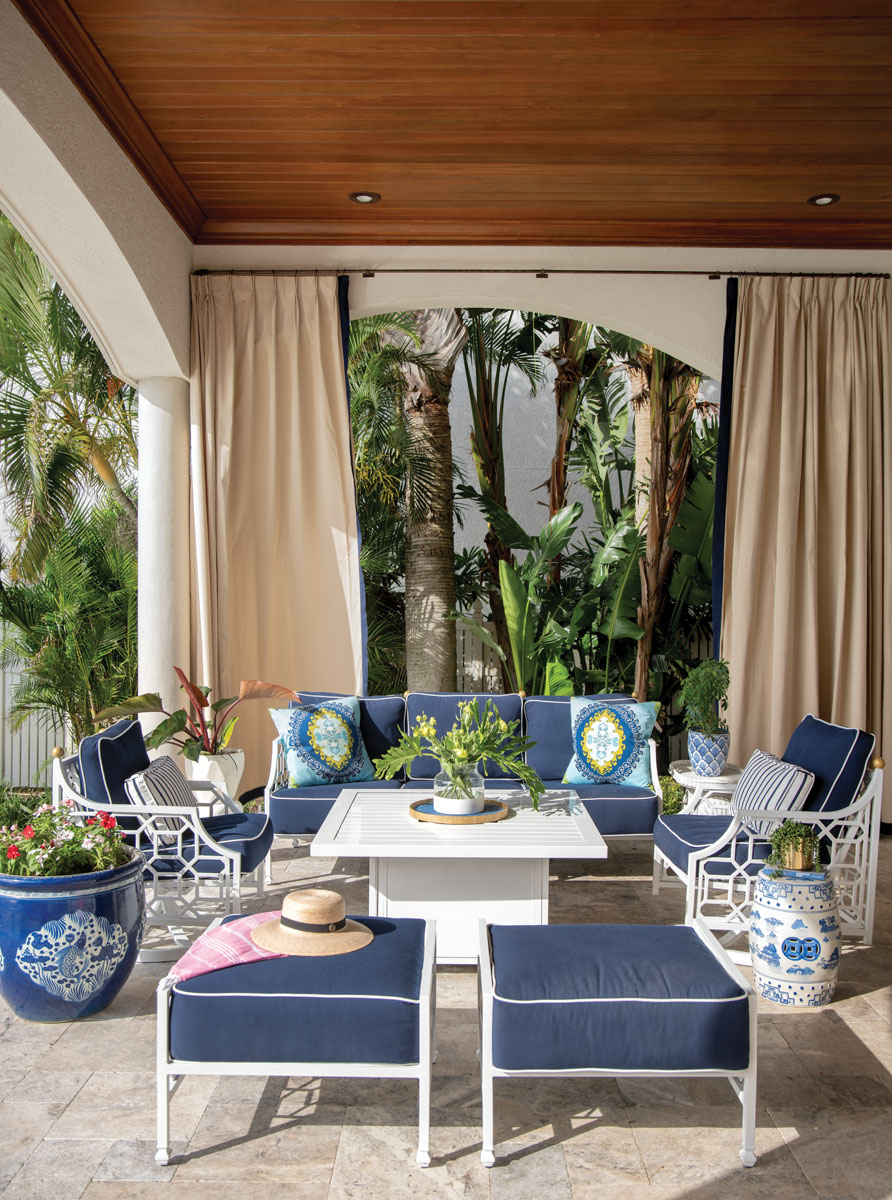 Serene hues of teal and blue entice relaxation on the loggia while lounging in Castelle's sofa, swivel chairs and chaise lounges upholstered in navy blue.