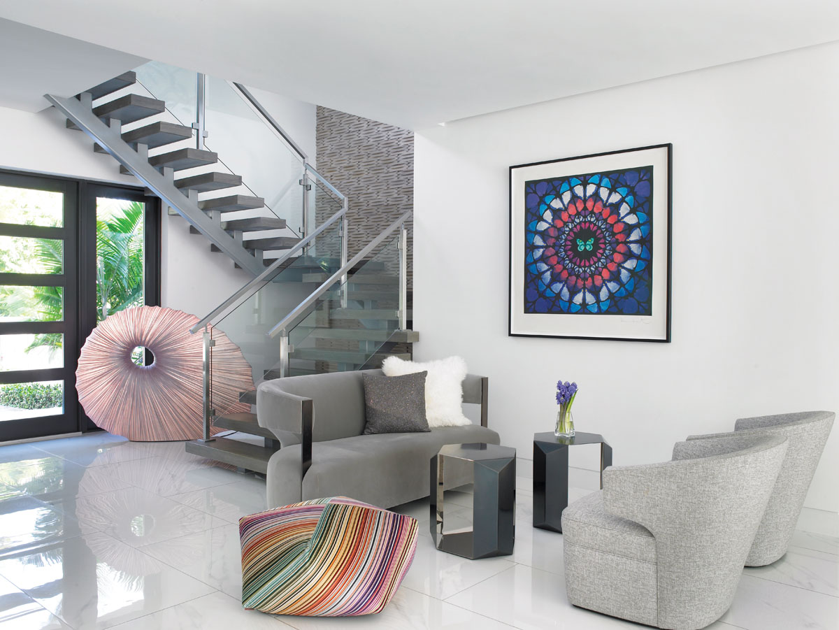 Missoni's hex-shaped velvet pouf displays all the hues of the rainbow in a finely striped pattern, while British artist Damien Hirst's Minaret presents a modern twist to a vintage kaleidoscope pattern that circles color around the intimate living area.
