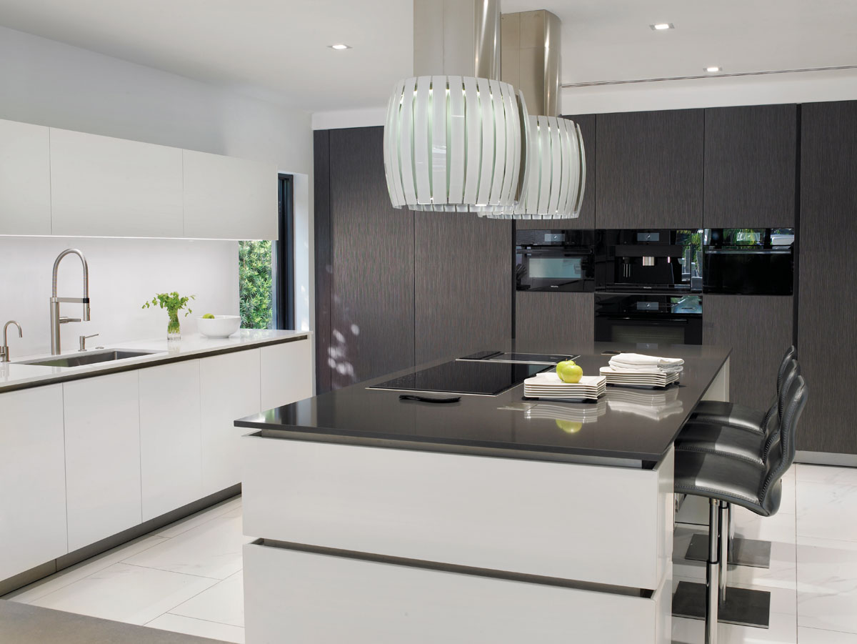 Accolades to the designer for selecting Futuro Futuro's impressive LED range hoods that appear to float above the kitchen island. Eggersmann cabinetry wraps the culinary space styled for entertaining as barstools from Addison House complete the contemporary vibe.