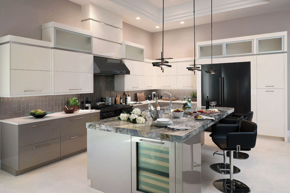 """This kitchen countertop is the drama queen that has to be the center of attention,"" Davenport says. Two-toned iridescent cabinets, painted glass subway tile backsplashes, and grounding black elements such as bar stools and other fixtures come together to create a glamorous place to sip wine and snack as the main course is being prepared."
