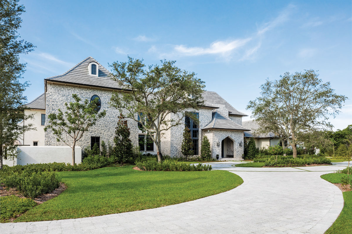 The home's exterior is clad in Sheridan ledgestone and a colored stucco veneer.