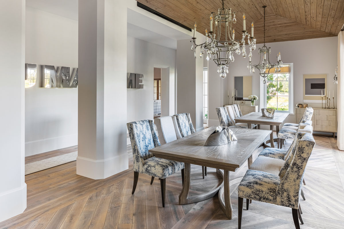 Function merges with form in the dining room, where a pie slice design details the tops of a pair of dining tables that expand for entertainment. Kravet chairs alternate patterns and solids.