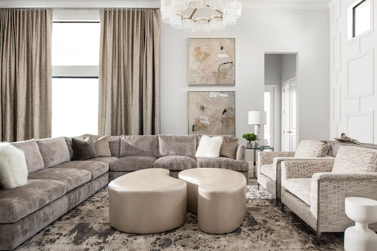 A massive, deep sectional from Bernhardt is meant to invite lounging in the family room. The coffee tables are custom pearlized leather made to order by Norwalk.