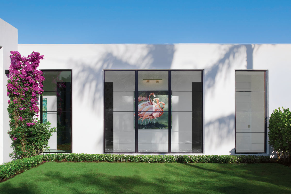 The home was designed to showcase a mix of the owners' indigenous art, as well as new pieces sought out by the design team. Long hallways create walls of windows that allow the collection to be viewed from the outside.