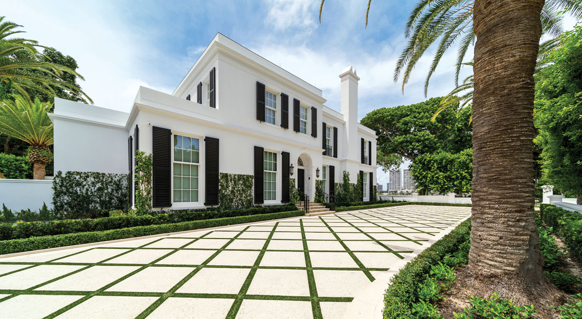 Architect Harold Smith partnered with Rogers General Contracting to restore the crumbling stucco exterior, painted it a brilliant white, and added black shutters and a black, custom-made, impact-resistant wood door and windows.