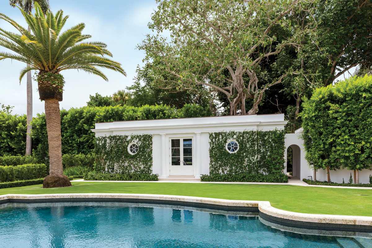 The home's existing cabana was expanded to accommodate an exercise room. Smith created a mirror image of the structure on the opposite side of the pool to house a game room, adding symmetry and functionality.