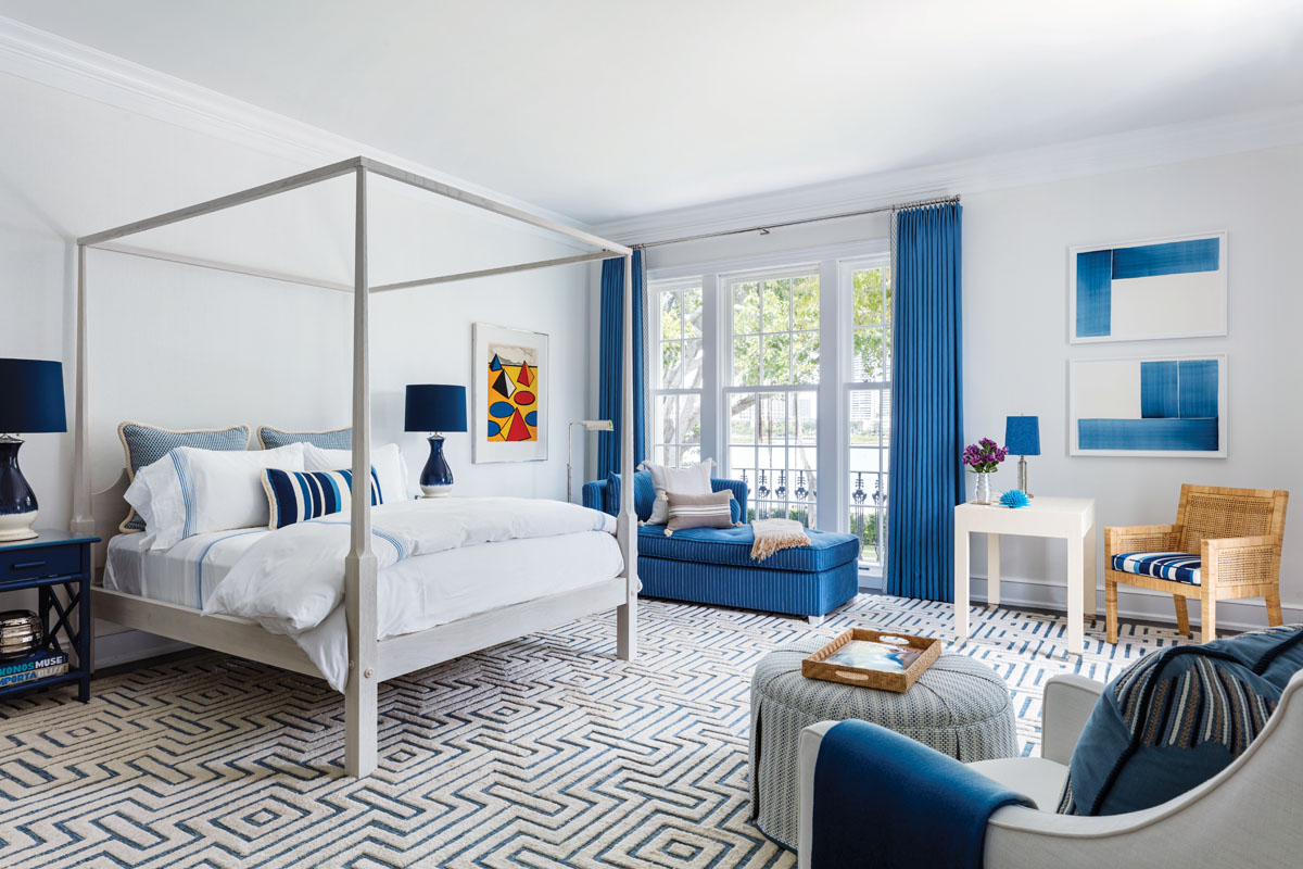 """""""This was a very fun room to do because it is a perfect example of high-low decorating,"""" Sanders said. He chose blue and white hues because they were soothing, and a nod to the landscape."""