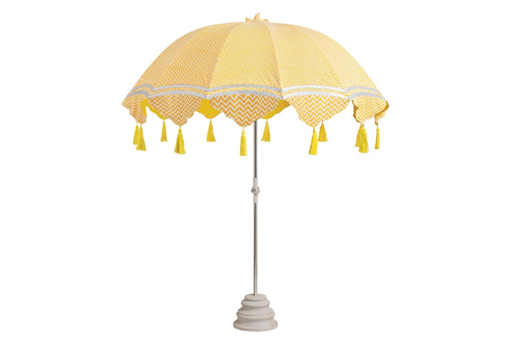 You'll be made in the shade under the tasseled Aretha umbrella from East London Parasol Company, available with interchangeable covers