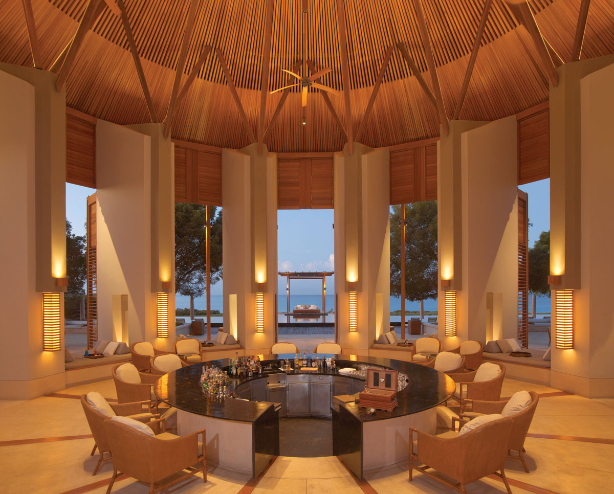 Vaulted ceilings soar above the circular structure that houses Amanyara's main bar. An open design with seating between columns ensures maximum interaction with the outdoors.