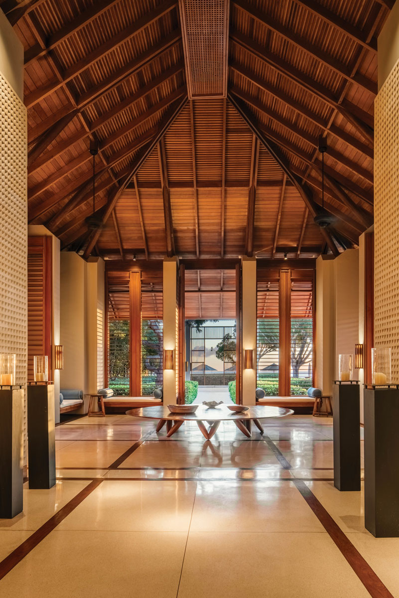 The lobby is the first introduction to the resort's extensive use of timber on ceilings, columns, shutters, and decorative structures.