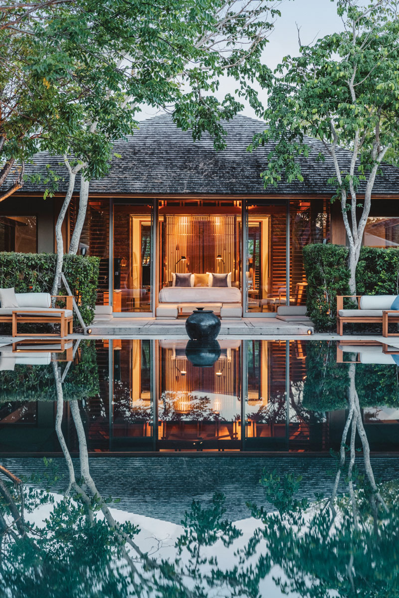 The four-bedroom Tranquility Villa features a black infinity-edge swimming pool and integrated indoor/outdoor areas. The villa's open plan and abundance of sliding glass doors invite views of ponds and gardens, as well as the ocean.