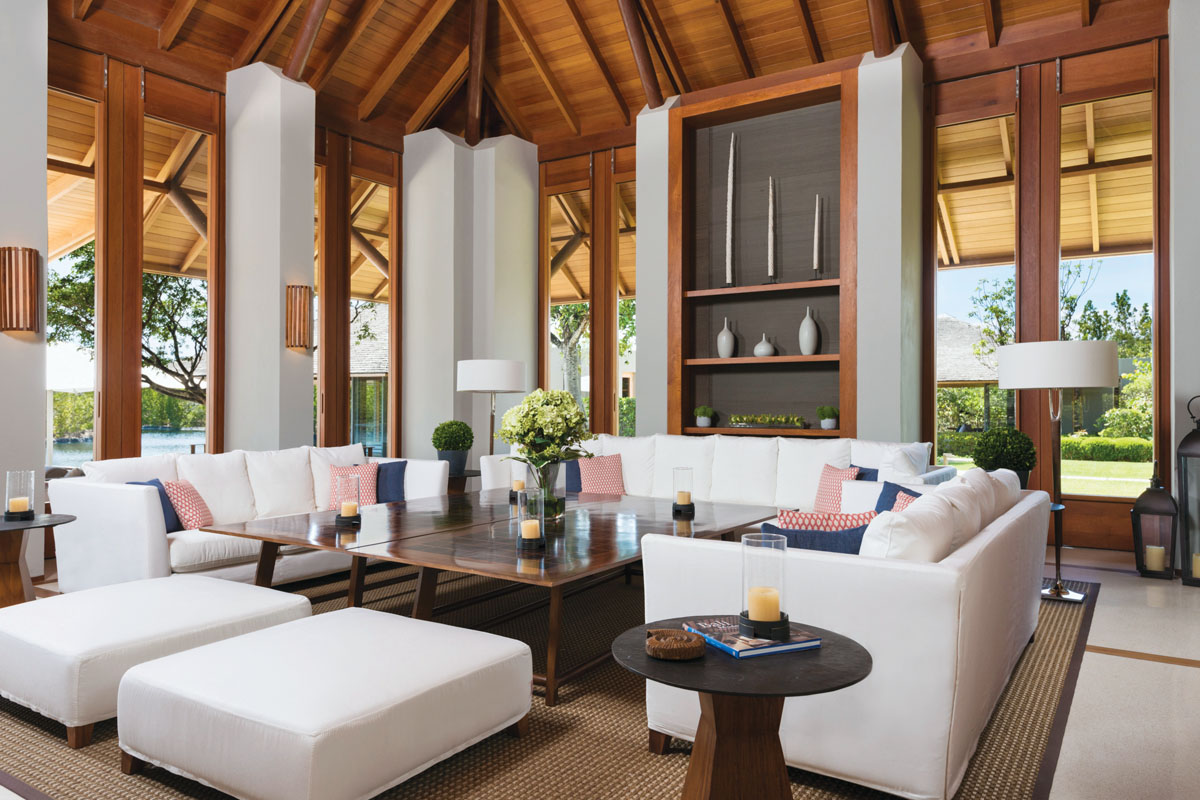 The Tranquility Villa living room offers a beautiful space to retreat from the sun while remaining connected to nature.
