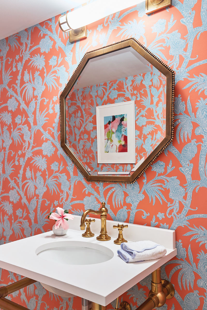 Libby Langdon Vero 31-2HPhotography by Aric Attas, Creative Thibaut's bright coral and turquoise wallpaper patterns the powder room, where brass accents on the Arteriors Home mirror and Restoration Hardware's sink feel fresh and pretty.