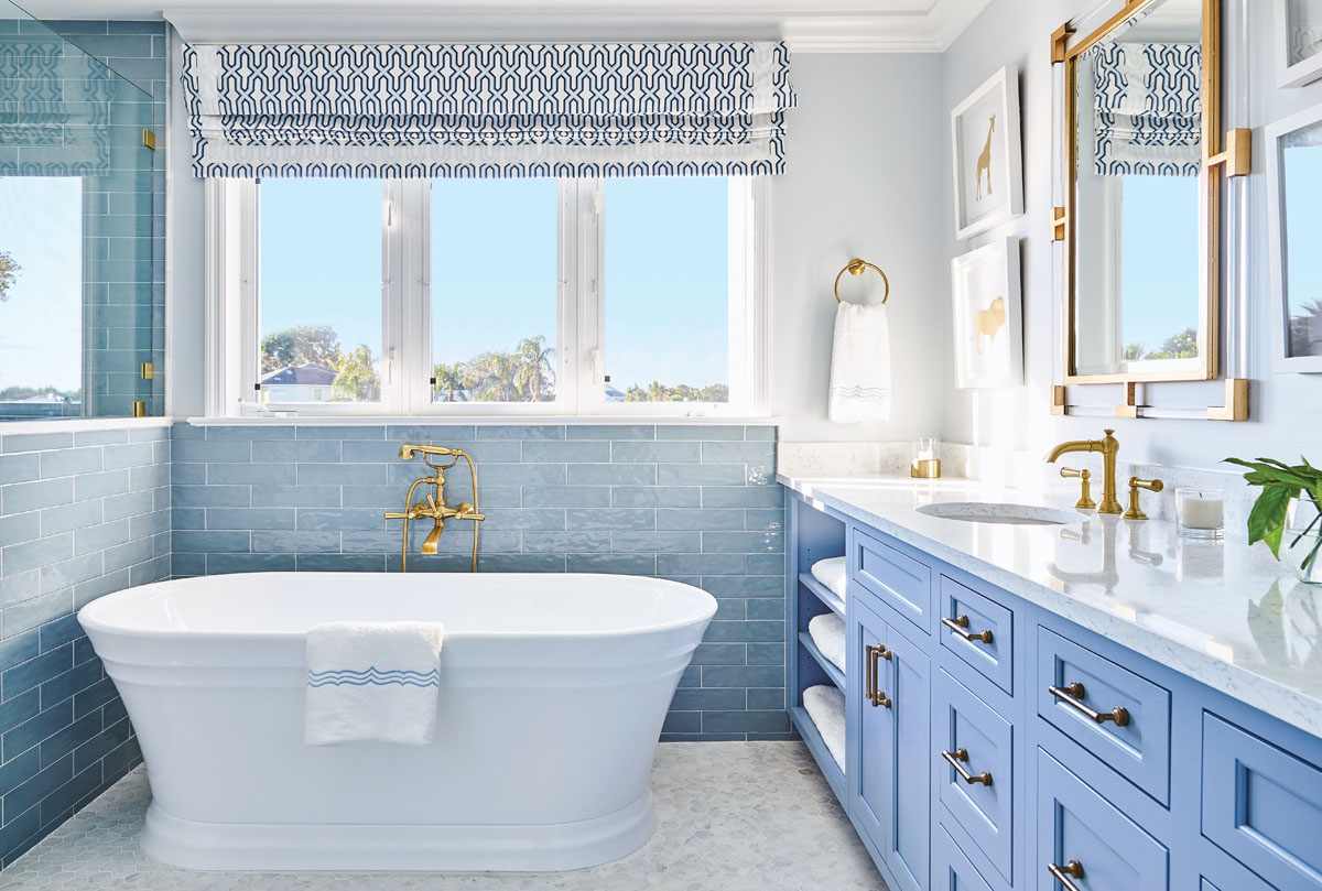 The blue palette of the bedchamber flows into the master bath outfitted in personality, pattern, and punch. Libby Langdon Vero 31-2LPhotography by Aric Attas, Creative