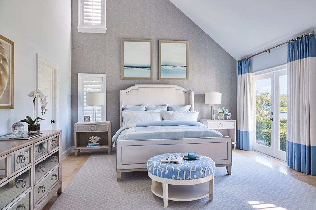 Libby Langdon Vero 31-2MPhotography by Aric Attas, Creative Thibaut's seagrass wallpaper and a pair of coastal landscape oil paintings from Wendover helped balance the angular wall in the master suite.