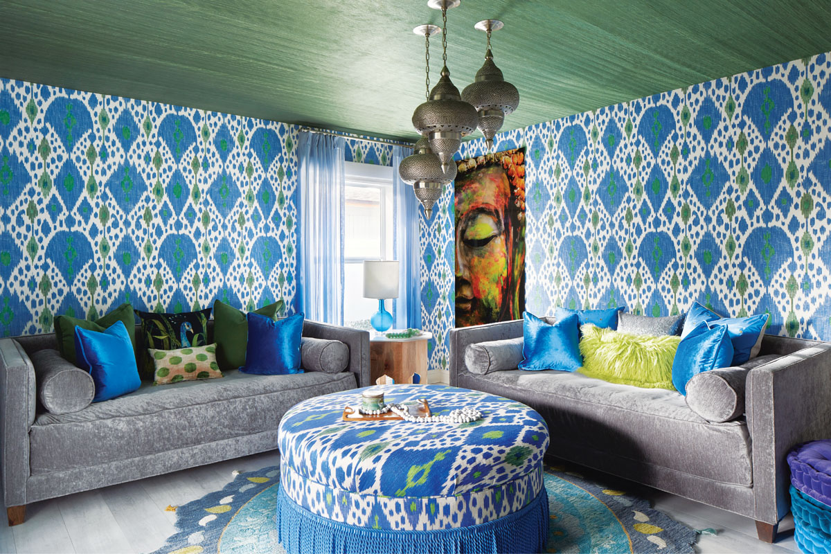 Robyn Branch_FD31-2D Photography by Zeke Ruelas Photography, Nashville, TN In the first floor guest den, Branch nudged the homeowner toward a more Moroccan-inspired look rich with deep greens and blues. Three pendants hang from the ceiling at staggered lengths, while the green-and-blue wallpaper brings the outside in. Floor cushions and throw pillows make it a perfect, quiet spot for the homeowner to meditate.