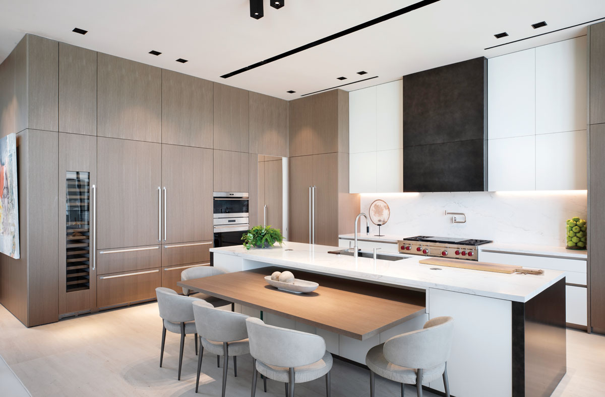 Boffi's streamlined cabinetry gives the kitchen a minimalist style, as an open-bar concept takes center stage. The European cabinetry continues in a secondary culinary space nestled behind hidden doors.