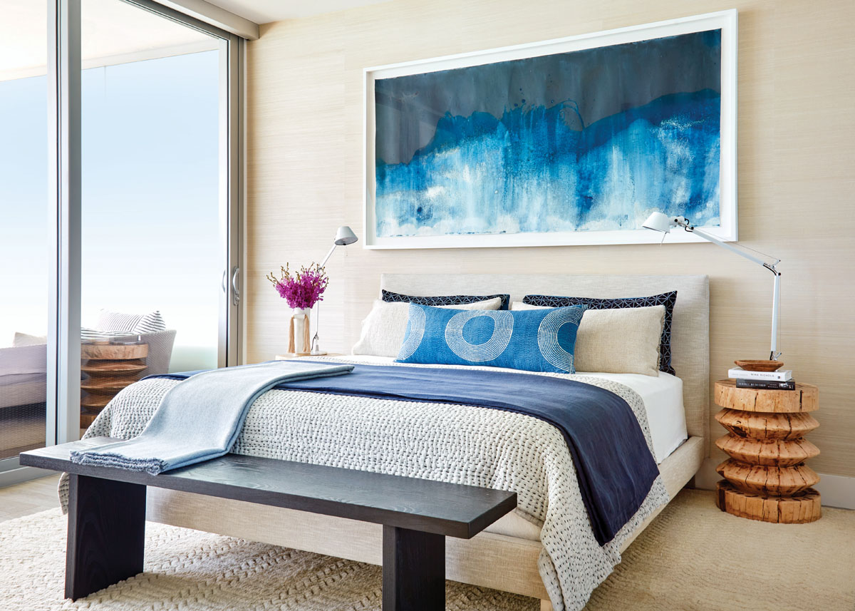 A cyanotype from Meghan Riepenhoff's Littoral Drift series recalls the ocean's colors, which are also evoked by throw pillows refashioned from a Blockshop quilt and antique linens. An acacia Zig Zag stool and Japanese bench from Tucker Robbins warm the bedroom's cool tones.