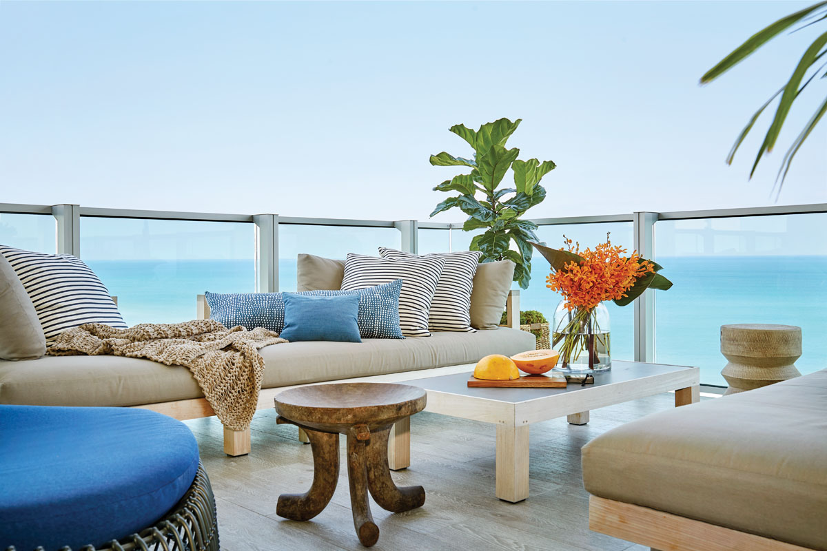 As Weitzman and her husband spend considerable time outdoors, she focused on comfort for her JANUS et Cie outdoor living room set, which she adorned with a lumbar pillow from St. Frank, striped pillows, and a textured blanket.