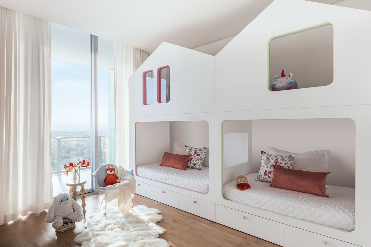 Built for imagination, the children's bedroom doesn't need a mountain of toys for little dreams to stir. With tiny, hip facades, the overhead playhouse holds two rooms. As elsewhere, the ceilings have been floated to provide soft, concealed LED lighting.