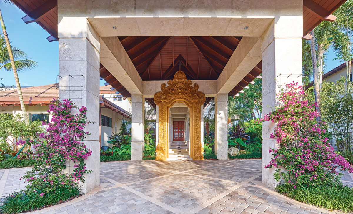 The homeowner wanted the larger of two temple doors to be used at the home's main entrance, in order to create an experience that includes lush landscaping and discreetly placed speakers that pipe out jungle sounds.