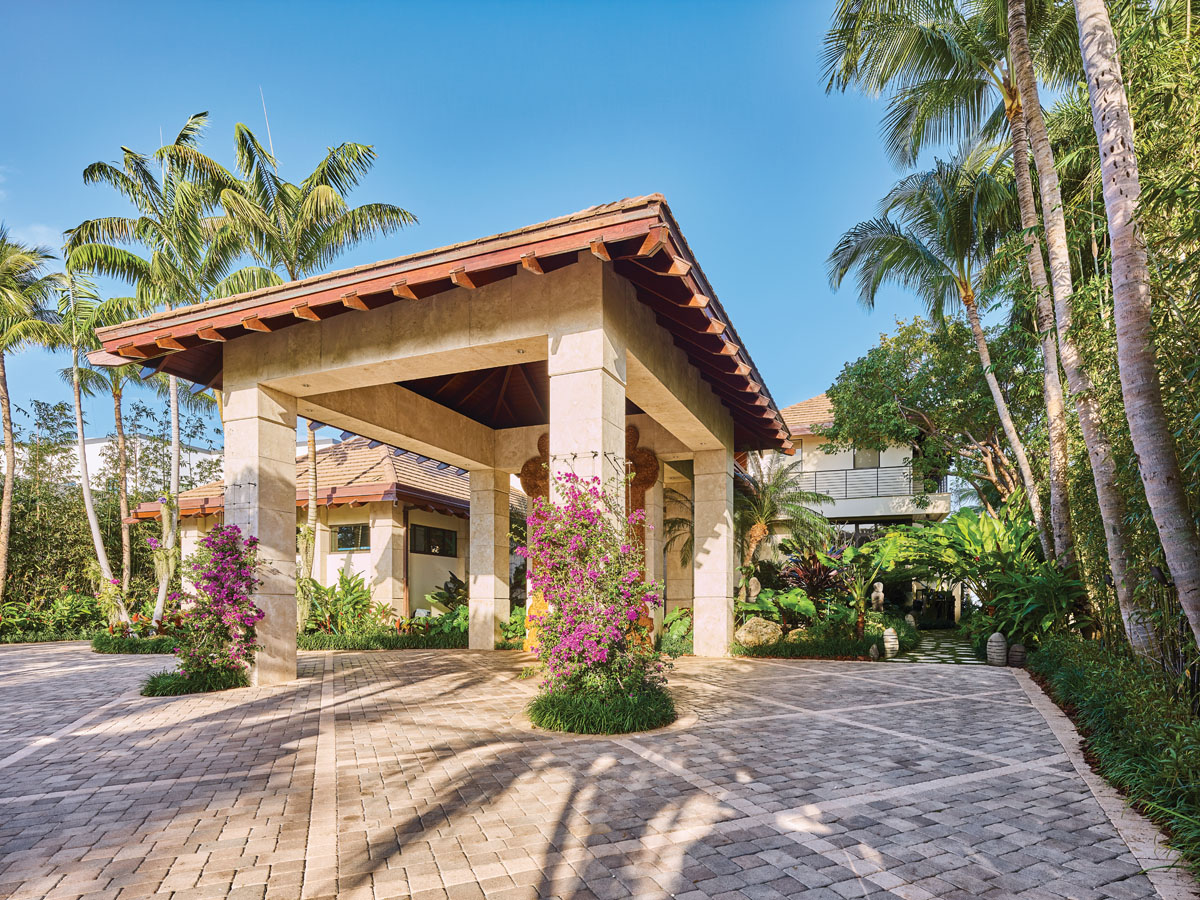The overhang to the main entrance offers visitors a resort feel, as if they can drive their car up, hand over their keys, and leave their troubles behind.