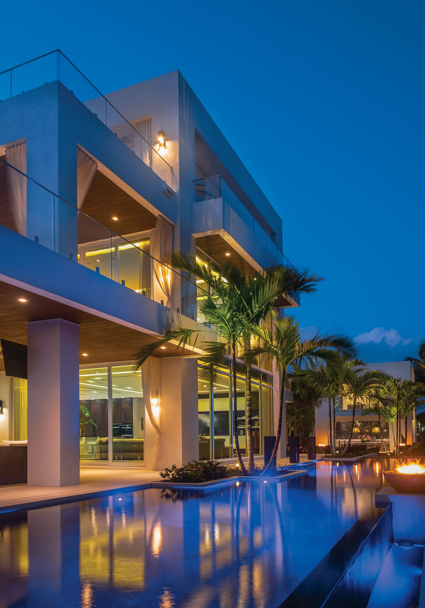 In a gated enclave along one of Fort Lauderdale's picturesque canals, the soaring profile of this three-story residence and its adjoining guesthouse cut a cool, contemporary figure.