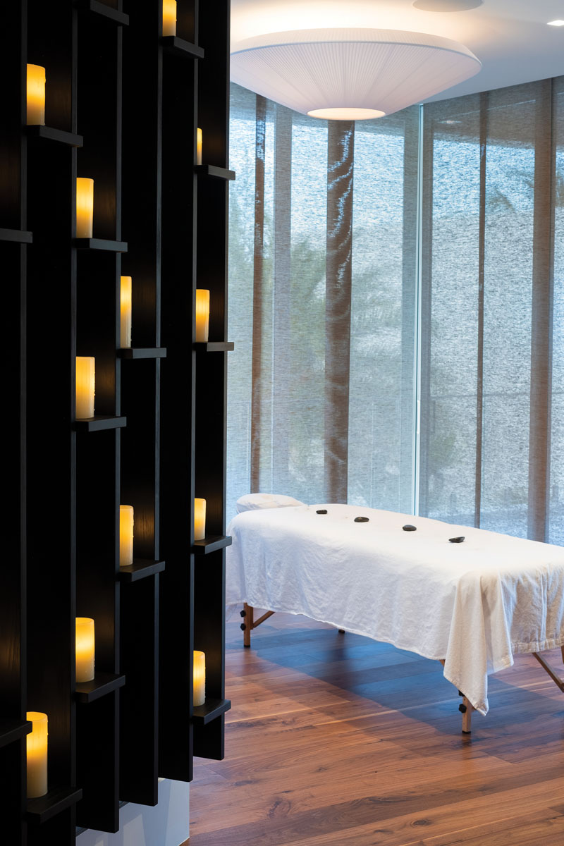 On the second floor (and just off an expansive waterfront balcony) lies a room dedicated to physical renewal. The massage room is simple in design and functional in purpose. With textured grass cloth window coverings and a grid built to hold electric candles, the essence of the Orient permeates the space.
