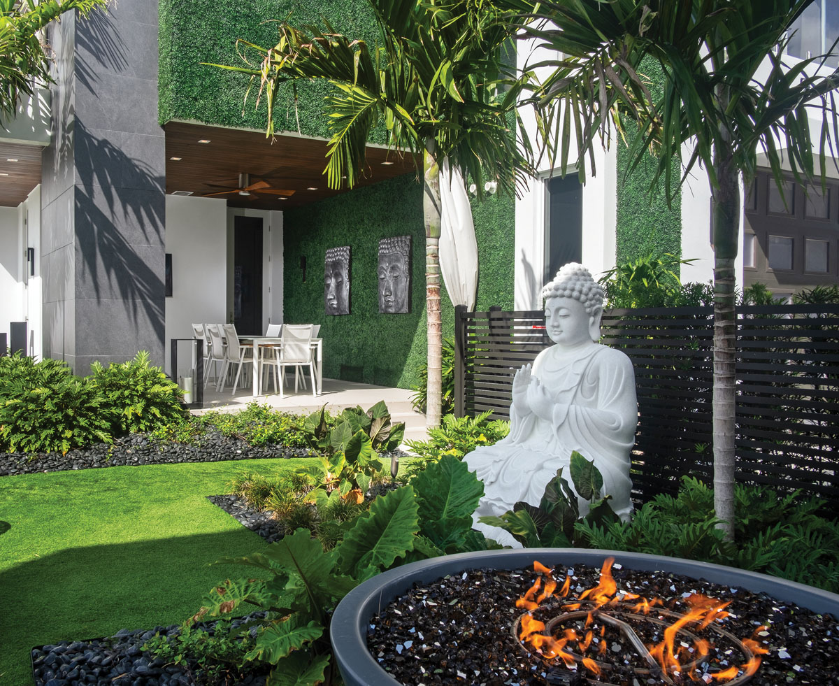 A Zen Buddha statue presides in the tranquility garden between the main home and the 1,400-square-foot guesthouse.