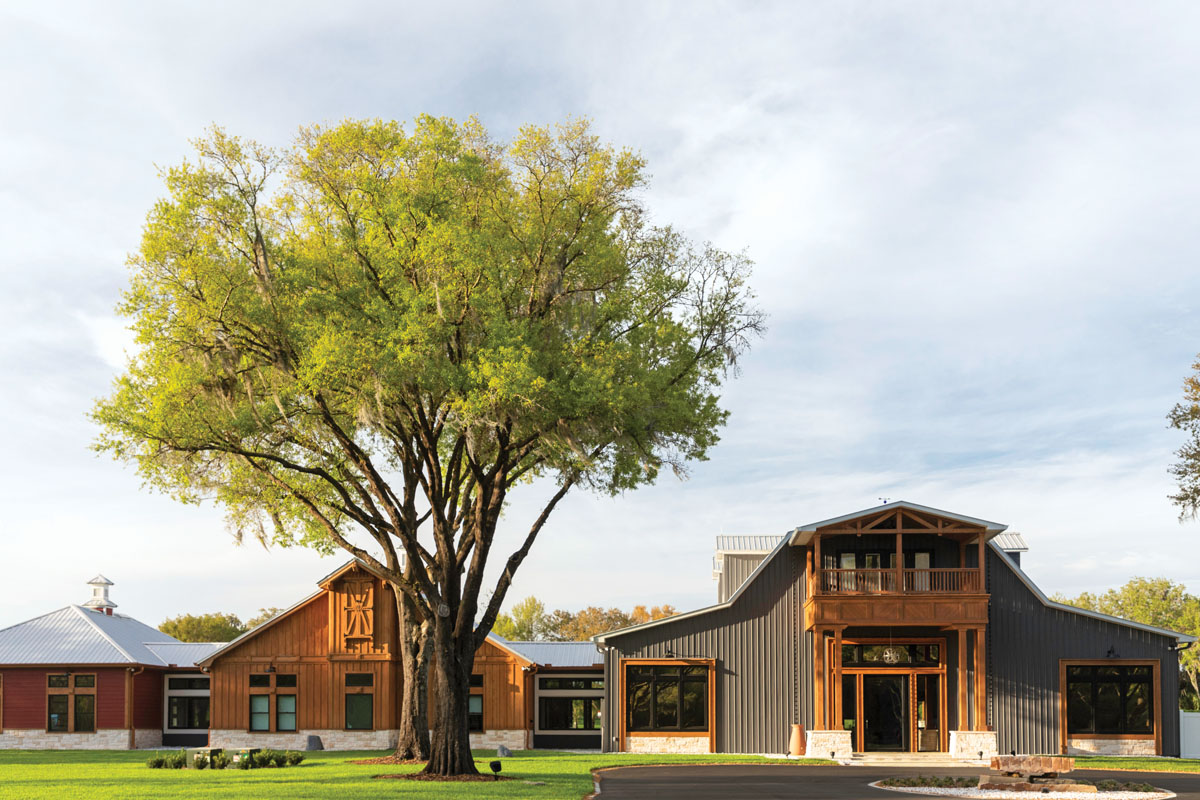The original barn's footprint was expanded by constructing two separate buildings that are tied together with glassed-in walkways, stone accents, cedar trim, and angled roof lines.