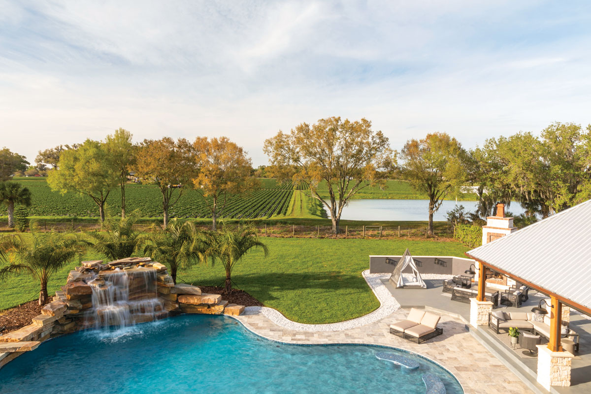 The pool's waterfall was built from pressure-washed rocks that the previous owner left on the property, giving the backyard a natural and peaceful vibe that feels like a boutique hotel.