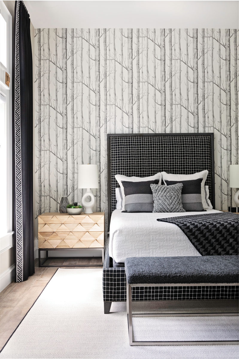 In the guest bedroom, the birch wallpaper guided the black and white palette that Timmerman used in the rest of the room.