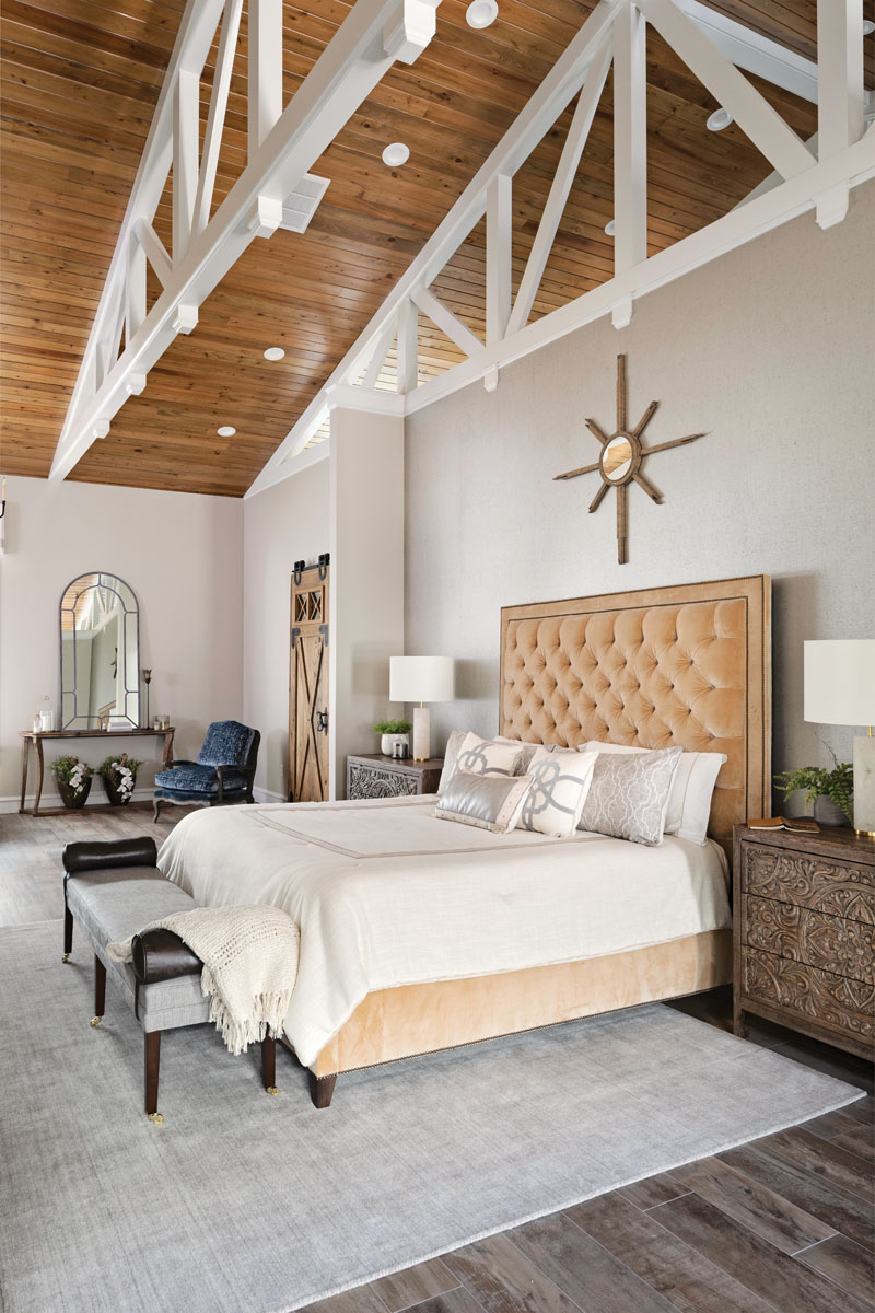 With its soft hues, eclectic textures, and separate seating areas, the large master bedroom suite gives Larry and Cathy a comfortable retreat, complete with their own walk-in closets and custom bathroom vanities.