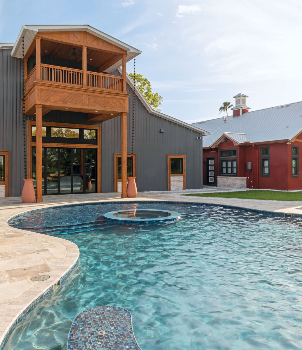 When you frequently entertain large crowds, it's important to go with the flow. Folding glass doors on the back of the house make it easy for the Jimenezes to extend the living space to the pool and pavilion.