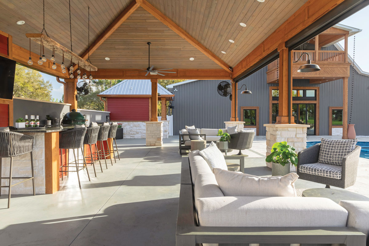 The Jimenezes are prolific entertainers, so they wanted a massive pavilion area with a bar, kitchen, masonry fireplaces, multiple seating areas, televisions, fans, outside dressing rooms, and an area for a band to play.