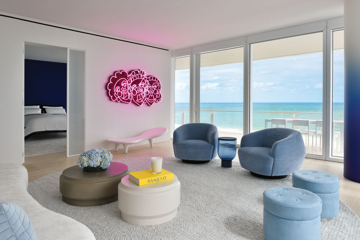 The The pink neon art is Wash N' Set by Tschabalala Self above a white fiberglass Orgone chaise by Marc Newson.