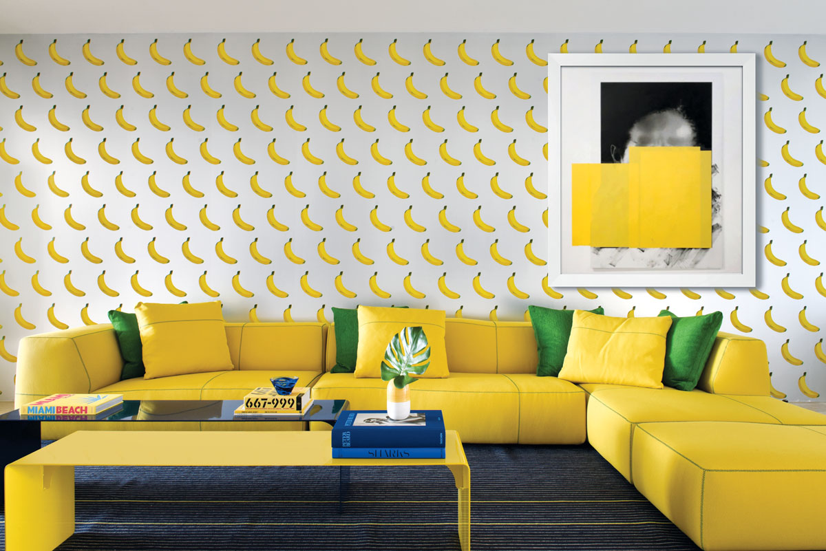 The B-A-N-A-N-A-S foil wallpaper by Flavor Papers in New York (which is scratch & sniff and smells like bananas) sets a fun mood in the family room and picks up the saturated yellow from the B&B Italia sectional.