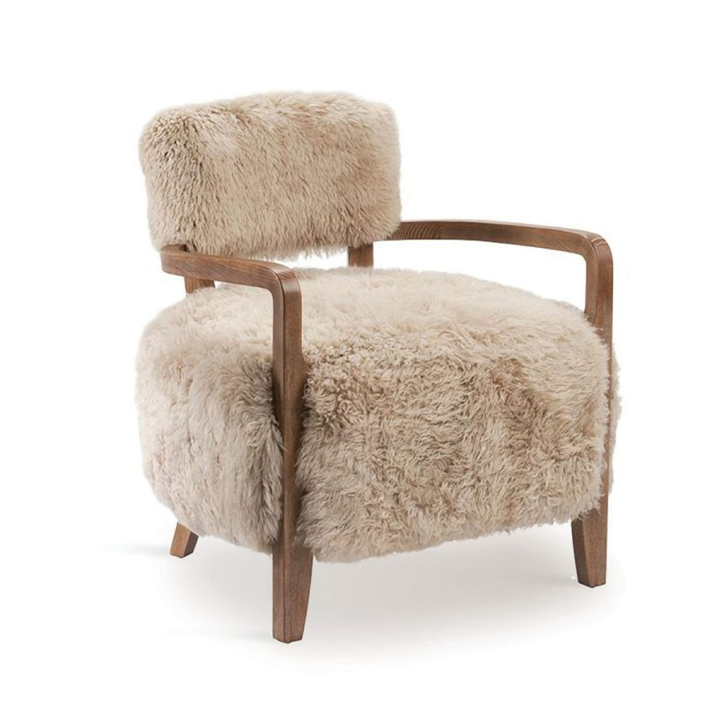 The Royce lounge chair from INTERLUDE HOME offers creature comfort with its genuine sheepskin upholstery. interludehome.com