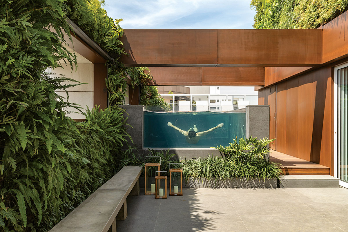 The installation materials themselves are two inches thick and can be added to almost any wall space—like this privacy courtyard.